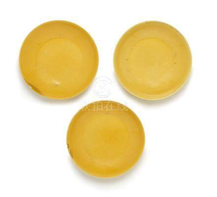 Three yellow-glazed saucer dishes  Daoguang seal marks and of the period  (3)