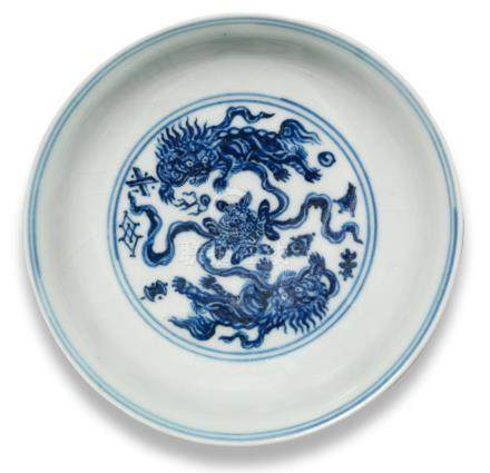 A blue and white 'Buddhist lions' saucer-dish Xuande six-character mark and of the period  (2)