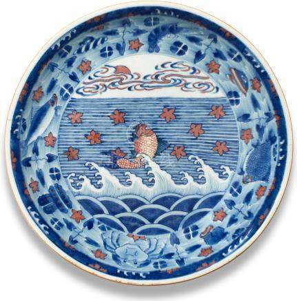 A blue and copper-red 'carp' saucer-dish Kangxi