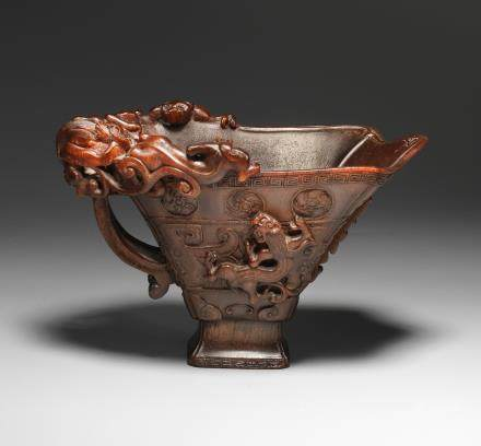 A finely carved rhinoceros horn 'chilong' libation cup 17th century