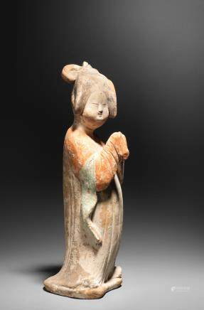 A pottery figure of a court lady  Tang Dynasty