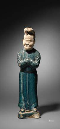 A rare blue-glazed pottery figure of a male attendant  Tang Dynasty