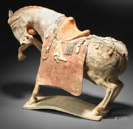 A rare painted pottery figure of a prancing horse Tang Dynasty