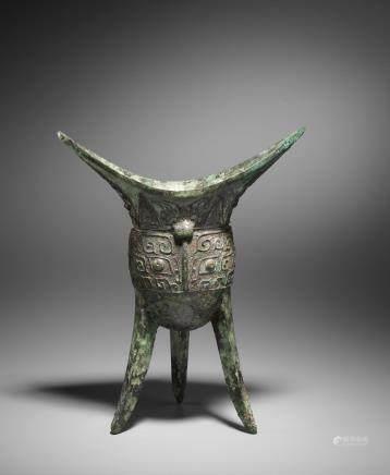 A very rare archaic bronze tripod vessel, Jiao Late Shang Dynasty
