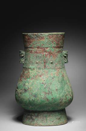 A large and rare archaic bronze vessel, Hu Late Shang Dynasty