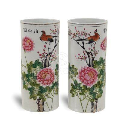 Pair of cylindrical porcelain and polychrome enamel