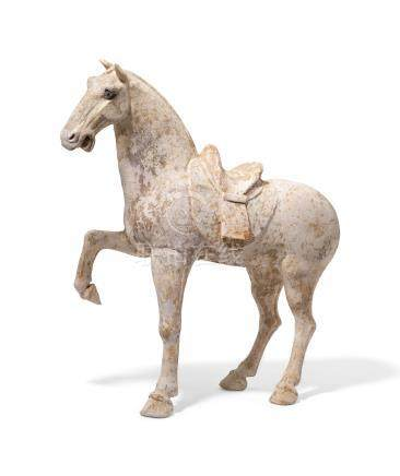 A PAINTED POTTERY HORSE