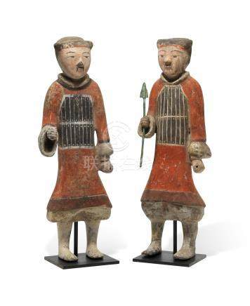 TWO PAINTED POTTERY FIGURES OF SOLDIERS