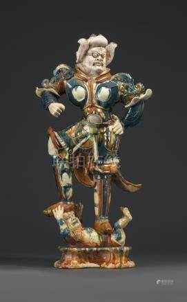 A MAGNIFICENT SANCAI AND BLUE-GLAZED POTTERY FIGURE OF A GUARDIAN WARRIOR