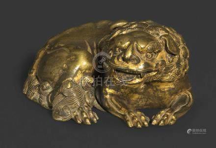 A GILT BRONZE FIGURE OF A BUDDHIST LION