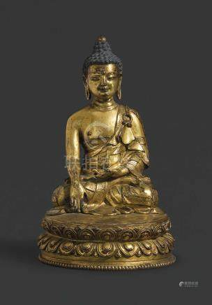 A CAST AND REPOUSSÉ GILT BRONZE SEATED FIGURE OF BUDDHA