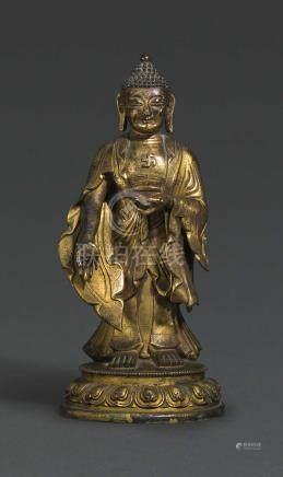 A GILT BRONZE STANDING FIGURE OF BUDDHA