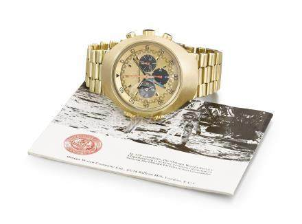 Omega. An extremely rare 18K gold dual time zone chronograph wristwatch with bracelet