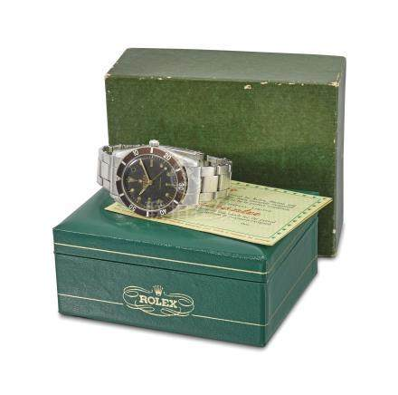 Rolex. A rare and early stainless steel automatic wristwatch with sweep centre seconds, bracelet, blank guarantee and box