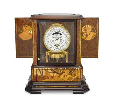 Jaeger-LeCoultre. An exceptional and very rare wood, gilt brass and glass limited edition art nouveau style atmos clock with 1000 year calendar and moon phases, wood marquetry panels by Philippe Monti and Jérôme Boutteçon after Alphonse Mucha