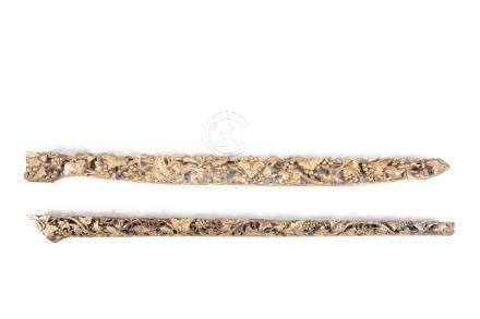 TWO SIMILAR CHINESE CARVED GILTWOOD LONG PANELS, both decorated with vines and squirrels. 128 and