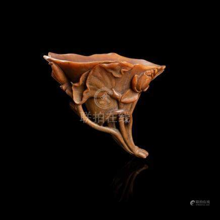 Y RARE WELL-CARVED RHINOCEROS HORN 'LOTUS' LIBATION CUP QING