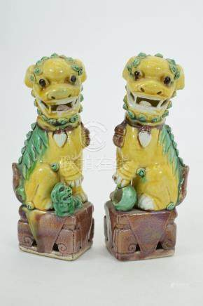 PAIR CHINESE POLYCHROME PORCELAIN FOO LIONS