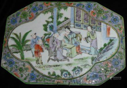 AN 18TH CENTURY CHINESE FAMILLE VERTE PORCELAIN PLAQUE Lozenge shape with a central cartouche,
