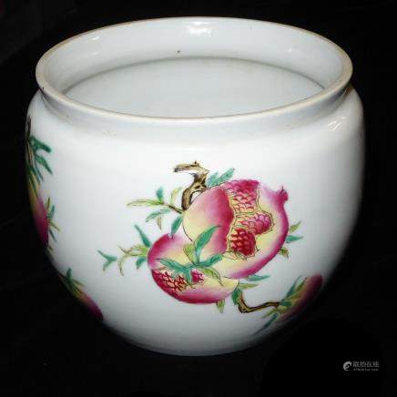 A CHINESE FAMILLE ROSE PORCELAIN VASE Hand painted with peaches and exotic fruit, bearing a red