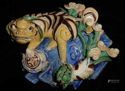 AN CHINESE YELLOW GLAZE POTTERY WALL POCKET Modelled with two stylized dragons with a censor on blue