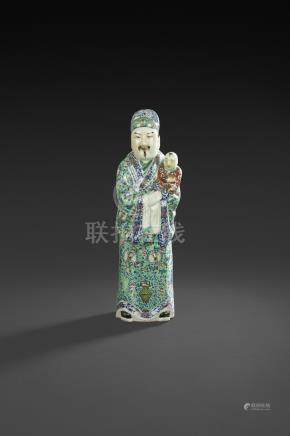 CHINE - XXe siècleImportante statuette en porcelaine émaillée polychrome de dignitaire debou