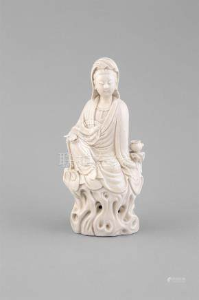 A BLANC DE CHINE MODEL OF GUANYIN,C.1700, seated at royal ease wearing a beadednecklace and draped