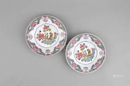 A PAIR OF FAMILLE ROSE DISHES, YONGZHENG (1723-1735) each painted and enamelled with a pair of