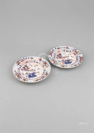 A PAIR OF CHINESE IMARI DISHES, 18th Century, each painted with bamboo, lotus and rockwork groups