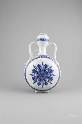 A MING REVIVAL BLUE AND WHITE DOUBLE GOURD FLASK, 17th century, of near eastern inspiration, the