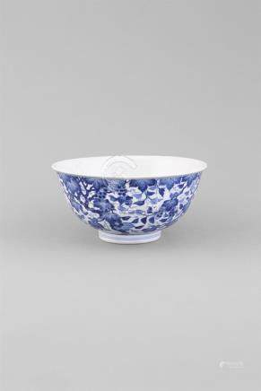 A BLUE AND WHITE 'SQUIRREL AND GRAPE' BOWL, Qinglong (1736-1795) the deep rounded sides rising to an