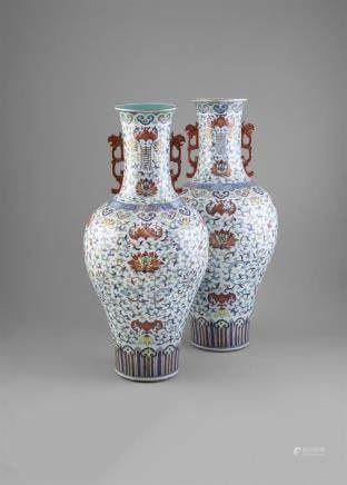 A LARGE PAIR OF DOUCAI ENAMELLED LOTUS VASES, Daoguang (1821 - 1850), of baluster shape, colourfully