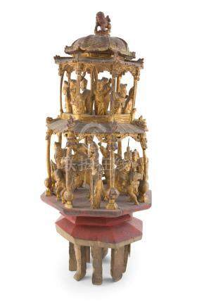 A CARVED GILTWOOD PAGODA, surmounted with a kylin animal finial above two open tiers, fitted with