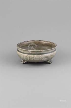 A PALE CELADON GLAZED TRIPOD CENSER,Song Dynasty (960-1279), of circular form, with channelledrim,