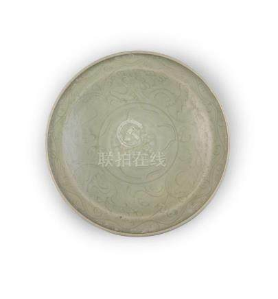 A LONGQUAN CELADON DISH, c.14/15th, of circular form with lipped rim, decorated with floral