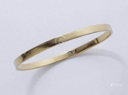 Bracelet jonc en or 750 millièmes.  Poids brut: 16 g. Diam: 5.6 cm.