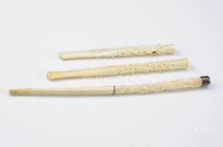THREE ANTIQUE CHINESE IVORY CIGARETTE HOLDERS