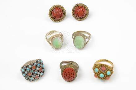 LOT OF CINNABAR, JADE, AND ENAMEL RINGS