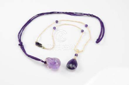 TWO CHINESE AMETHYST CARVED PENDANTS