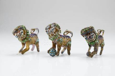 THREE CHINESE VERMEIL SILVER AND ENAMEL LIONS