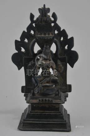 Bronze Deity. India. 15th century. Enthroned figure of