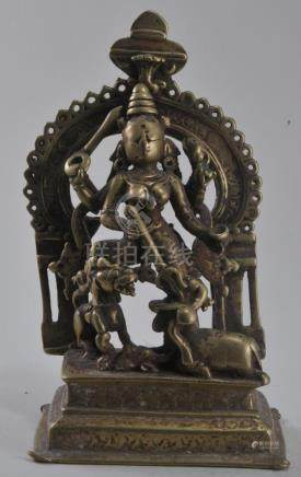 Bronze Deity. 17th century. Enthroned rampant figure of