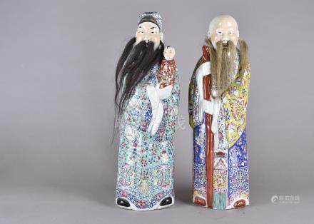 Two Chinese porcelain deities from the trio of the 'Stars of Happiness', comprising Fu-Sing with a