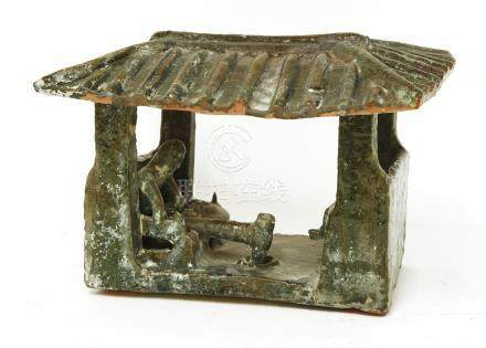 A Chinese barn model, Han dynasty (206 BC to AD 220), of rectangular form with four pillars ...