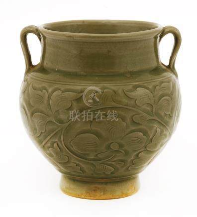 A Chinese Yaozhou ware vase, Song dynasty (960-1279), of baluster form on a raised foot, incised ...