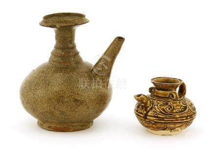 A Chinese pottery ewer, Song to Jin/Yuan dynasty, incised with a band of trailing foliage under a ...