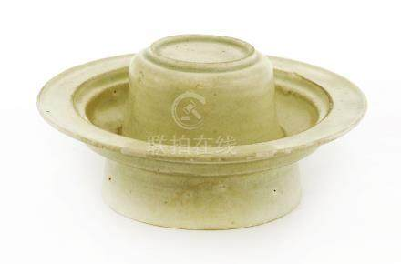 A Chinese qingbai ware cup stand, Song Dynasty (960-1279), of typical form covered with a light sea ...
