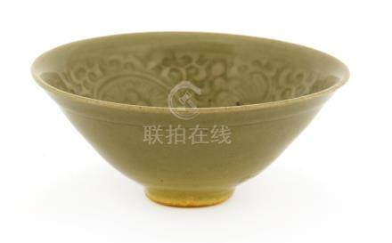 A Chinese Yaozhou ware celadon bowl, Jin dynasty (1115-1234), of circular form with splayed mouth, ...