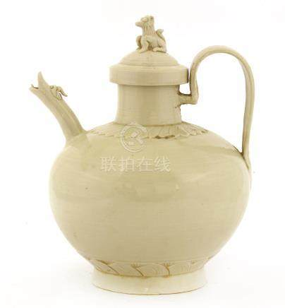 A Chinese Ding ware ewer and cover, Jin dynasty (1115-1234), of baluster form on a raised foot, ...
