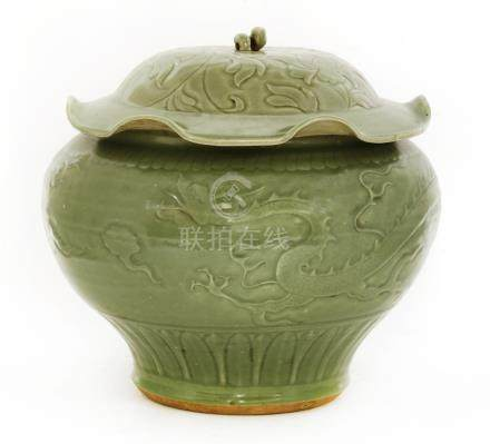 A Chinese Longquan ware jar and cover, Ming dynasty or later, of baluster form on a tapering foot, ...